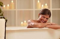 Woman in bathtub, portrait