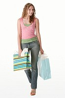 Teenager with shopping bags, portrait