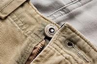 Close-up of metal button on pants
