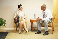Businessman talking to a businesswoman