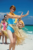 Senior woman hula dancing on the beach