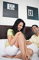 Mature couple smiling in the bed (thumbnail)