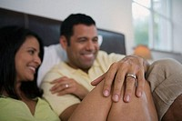 Close-up of a mature couple reclining in the bed and smiling