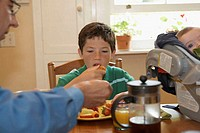 Boy having breakfast with his father