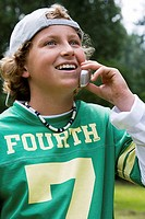 Close-up of a boy talking on a mobile phone (thumbnail)