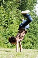 Side profile of a boy doing a handstand