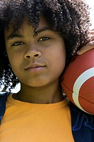 Portrait of a girl holding a football