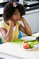 Portrait of a girl sitting at a breakfast table