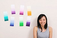 Close-up of a young woman smiling with color swatches on a wall