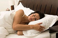 Close-up of a young woman sleeping in the bed (thumbnail)