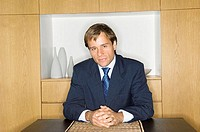 Portrait of a businessman sitting at a desk (thumbnail)