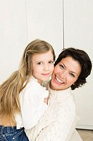 Portrait of a young woman smiling with her daughter (thumbnail)