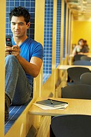 College student using a mobile phone