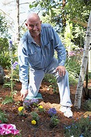 Portrait of a mature man gardening