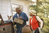 Middle-aged African American couple carrying fishing equipment (thumbnail)