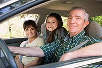 Hispanic family sitting in car