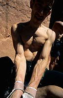Roberto Largo showing his wounded arms after climbing 'Supercrack' (5.10). Indian Creek. Utah. USA