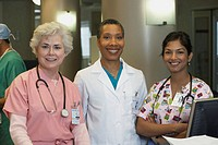 African female doctor with female nurses, Bethesda, Maryland, United States