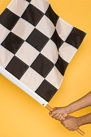 Close up of man waving checkered flag