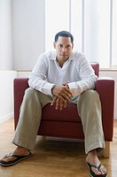 African American man sitting in chair