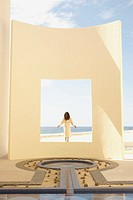 Woman in robe at beach resort, Los Cabos, Mexico (thumbnail)