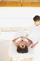 Woman receiving spa treatment outdoors, Los Cabos, Mexico