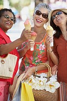 Group of middle-aged women eating ice cream cones, Miami, Florida, United States
