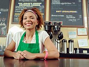 Waitress smiling at counter in coffee shop