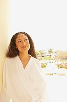 Woman in bathrobe outdoors at resort hotel, Los Cabos, Mexico