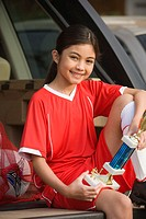 Young Hispanic girl with soccer trophy