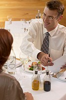 Young businessman and woman having lunch meeting, elevated view