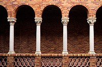Arched red brick colonnade