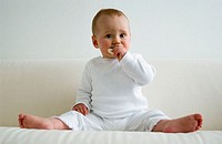 Baby eating a rice-cracker