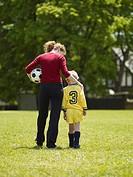 Mother and Son Walking Home After Soccer Game