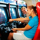Young couple playing an arcade game