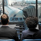 business executives sitting in an airport