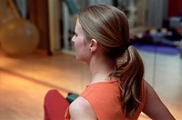 Young woman at the gym, fitness center, doing some exercise (thumbnail)