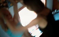 A boy and a girl, young couple or friends, in a room, blurred, unsharp