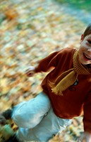 Little boy in the autumnal wood, forest, running