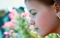 Portrait of a little girl in the garden (thumbnail)