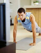 young man exercising on the floor