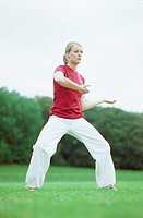 A young woman, 15-20 20-25 25-30 years old, practicing Yoga, Tai Chi, Qi Gong (thumbnail)