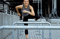 A young athletic woman, 15-20 20-25 25-30 years old, blond, sporty, overleaping a barrier (thumbnail)