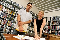 A young man and a young woman, business people, in an office, agency
