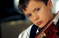 A boy, 5-10 years old, playing a violin (thumbnail)