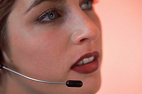 Headshot of woman wearing telephone headset