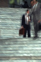 businessmen on stairs