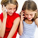 two girls (5-8) talking on mobile phones