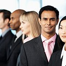 Close-up of a group of young executives standing in a single line