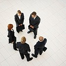 Elevated view of a meeting of young business executives